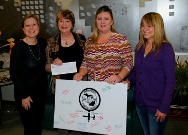 Members of the KICLC Women's Caucus presented the Women's Resource Center with a check for $1,301.57. From left, WRC Development Manager Brooke Detgen, WRC Executive Director Sharon Caldwell, Women's Caucus chair Lisa Bennett (OPEIU) and Lisa Angus (GREIU). February 2016