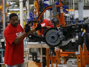 An assembly line worker builds a 2015 Chrysler 200 automobile at the Sterling Heights Assembly Plant in Sterling Heights, in 2014. Photo courtesy of the Detroit Free Press